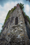 Old castle tower overgrown with vines Royalty Free Stock Image