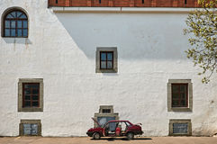 Old castle wall with car in Dubno, Ukraine Royalty Free Stock Photos
