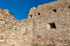 Old castle wall. Ruined medieval castle wall detail stock photo
