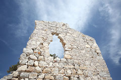 Old castle wall ruines on island Rhodes. Old castle ruines, wide clear blue sky stock image