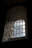 Old castle window in darkness. Dungeon old window in darkness with spiderwebs Stock Photos
