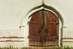 Old castle wooden gate taken closeup and white wall. Stock Images