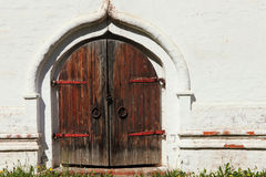 Old castle wooden gate and white wall. Royalty Free Stock Photos