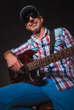Old casual man having fung while playing electric guitar Royalty Free Stock Photography