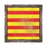 Old Catalonia flag. 3d rendering of a Catalonia Community flag over a rusty metallic plate wit a rusty frame. Isolated on white background Royalty Free Stock Photos