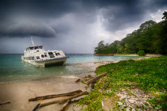 Old Catamaran stranded. In the contadora island beach Royalty Free Stock Photo