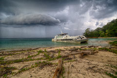 Old Catamaran stranded. In the contadora island beach Royalty Free Stock Image