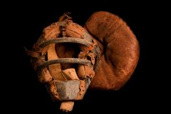 Old Catcher's Equipment. A very old catcher's mask and glove Royalty Free Stock Image