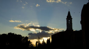 Old cathedral silhouette in Pienza, Tuscany Stock Image