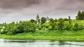 Old cathedral in trees near river stock video footage