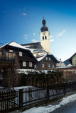 Old catholic church at Austrian village covered by snow Royalty Free Stock Images