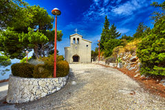 Old catholic church in mountain. Makarska, Dalmatia, Croatia Royalty Free Stock Image