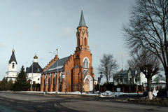 Old catholic church on the town square. Historical catholic church on the town square Stock Photo