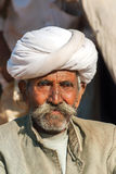 Old cattle farmer with white turban. Royalty Free Stock Image