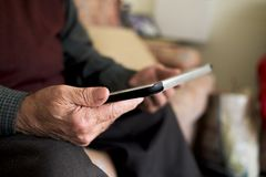 Old caucasian man using a tablet royalty free stock image