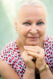 Old caucasian woman smiling at camera Royalty Free Stock Images
