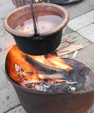 Old cauldron with lit fire and boiling water. Old copper cauldron with fire and boiling water royalty free stock photos