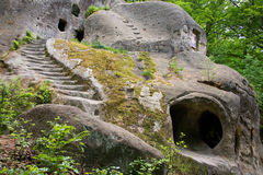 Old cave monastery in the forest Royalty Free Stock Images