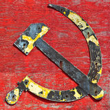 Old cccp hammer and sickle logo. Part of an old wooden shipwreck with the cccp hammer and sickle in steel attached to it stock photo