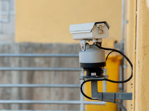 Old cctv and yellow wall Stock Photo