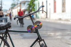 Old CD's or DVD's used as bycicle reflectors in Cuba Royalty Free Stock Photos