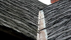The old cedar wooden shingle shake roof of the house with water tin stock video footage