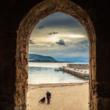 Old Cefalu beach through the archway Royalty Free Stock Images