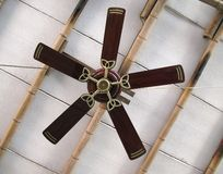 Old Ceiling Fan. A ceiling fan with five blades on a simple bamboo ceiling royalty free stock image