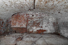 Old cellar. Old abandoned cellar with brick walls and vaulted ceiling - underground royalty free stock photos