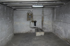 Old cellar obsolete and deteriorated. Electrical instal.lacion stock photography