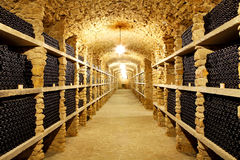 Old cellar of the winery Bottles of wine in the future Huge ware Royalty Free Stock Photos