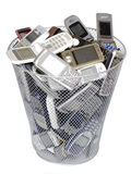 Old cellphones. Rubbish bin full of old cellphones Stock Image