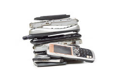 Old cellphones and battery. Electronic waste concept Stock Images
