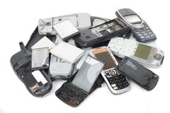 Old cellphones and battery Royalty Free Stock Photography