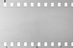 Old celluloid film with dust and scratches. Old celluloid film strip with dust and scratches Royalty Free Stock Photography