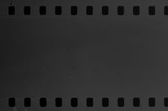 Old celluloid film with dust and scratches. Old celluloid film strip with dust and scratches Stock Photos
