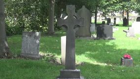 15 s cross. Old Celtic cross on cemetery stock video footage