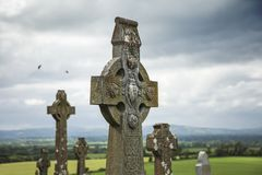 Old celtic cross and graveyard, Ireland royalty free stock photos
