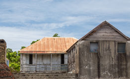Old Cement Building with Tin Roof Royalty Free Stock Photography