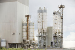 Old cement factory machinery. Cement silo. Stock Photos