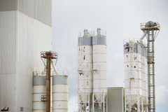Old cement factory machinery. Cement silo. Stock Photo