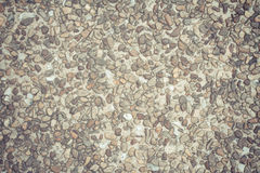 Old cement floor surface covered with stones Stock Image
