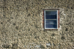 Old cement or masonry wall with window Royalty Free Stock Photo