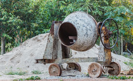 Old cement mixer. In thegarden cement, mixer, electric Royalty Free Stock Photos