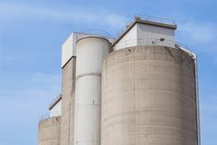 Old cement silos and blue sky background.  Royalty Free Stock Photos