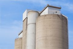 Old cement silos and blue sky background.  Stock Photography