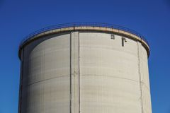 Old cement silos and blue sky background.  Stock Image