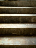 Old cement stair. With sunshine falling on them Royalty Free Stock Photo
