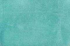 Old cement wall with net and stains, texture concrete background. Turquoise, motton blue, mint and tiffani colors royalty free stock photos
