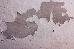 Old cement wall with peeling paint. Royalty Free Stock Photo